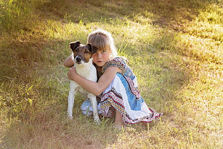 girl hugging the Jack Russell terrier