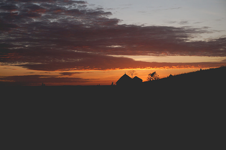 silhouette of house during sun set