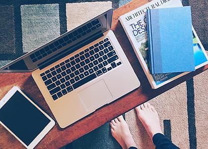 MacBook Pro near tablet
