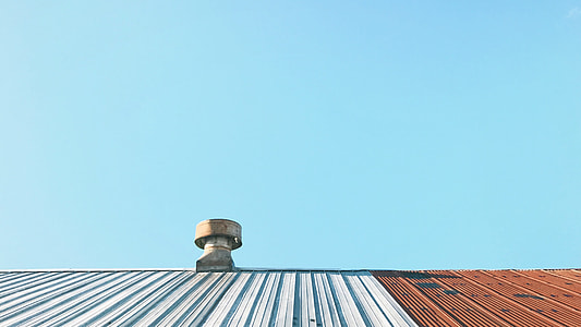 brown roof accessory on top of white and brown rood
