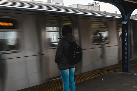 Photo of Woman Waiting at the Train Station
