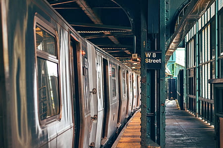 train on station with W8 street sign