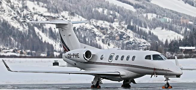 white CS-PHE plane on gray concrete ground
