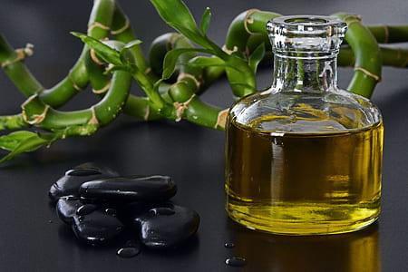 black stone beside glass of oil