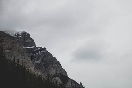 gray mountain under gray sky