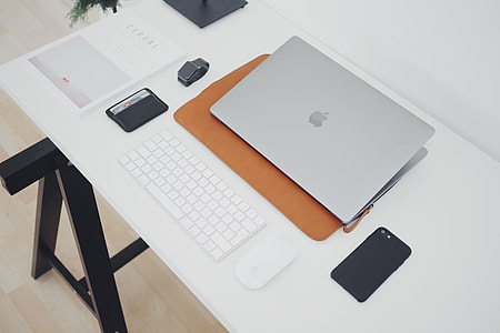 Office desktop with laptop and iPhone