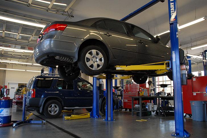 gray sedan on automotive raiser