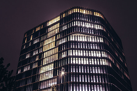 Office building at night with lights on