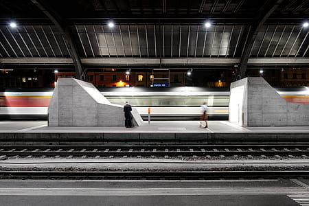person standing on train station