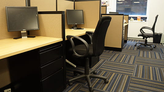 black rolling armchair in front of computer desk