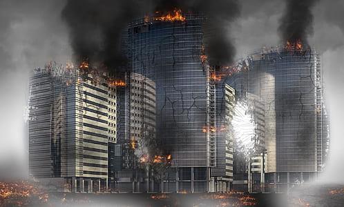 gray concrete building burning during daytime