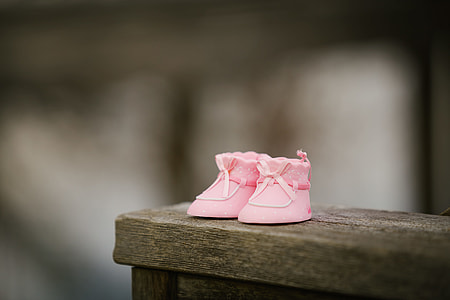 toddler's pair of pink shoes in selective color photography