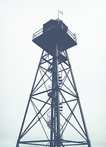 grey scale photo of light tower