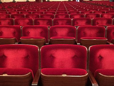 red suede chair arrangement