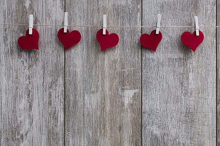 photo of five heart sticker clipped on string