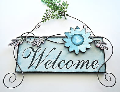 gray and black wooden welcome wall deco