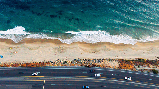 aerial photography of road beside the beach