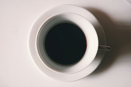 white ceramic tea cup filled with coffee