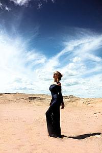 woman wearing black off-shoulder dress in the desert