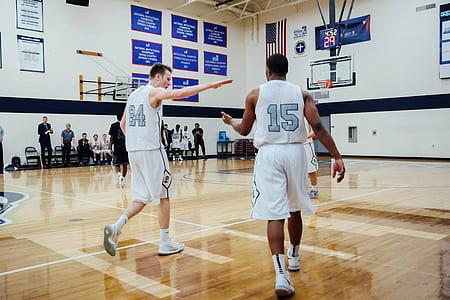 men in white basketball shirt