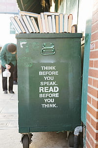 green wooden trash bin