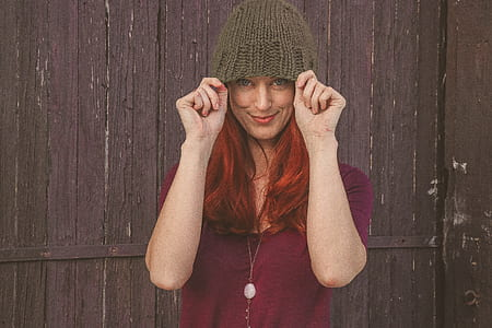 Woman Wearing Maroon Scoop-neck Shirt With Brown Knit Cap