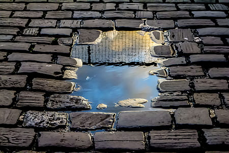 water puddle on brick floor