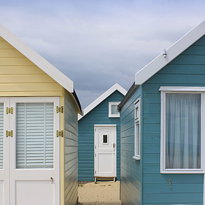 two houses side by side in front of another one