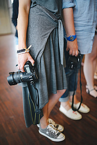 People with cameras at an exhibition