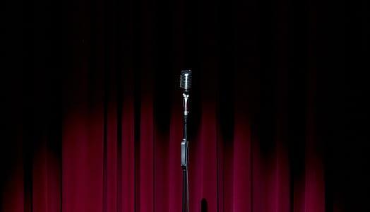 black microphone near red curtian