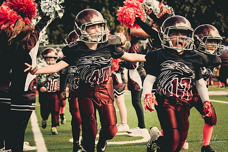 Children in White and Red Football Outfit