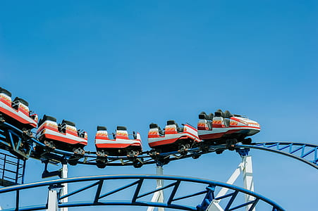 Red and White Roller Coaster on Railings
