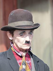 man in Charlie Chaplin costume