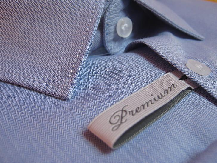 closeup photo of blue Premium button-up dress shirt