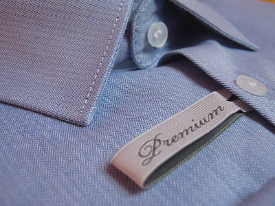closeup photo of blue Premium button-up dress shirt
