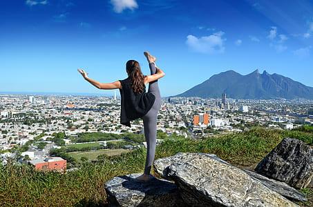 woman stretching during daytime