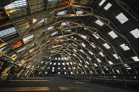 This is a wide angle shot of one of the main wooden buildings at Chatham Dockyard in Kent