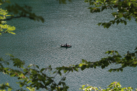 person sailing on brown boat at daytime