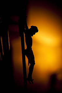 silhouette photo of crucifix