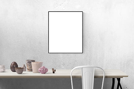 whiteboard placed on gray concrete wall