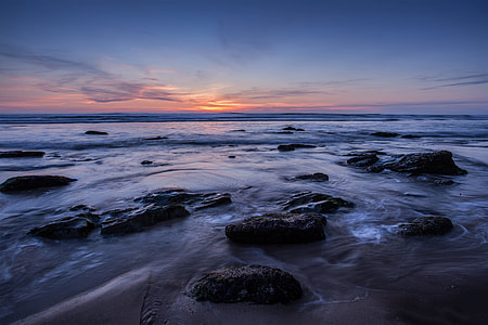 Wide-angle seascape image taken at sunset on the Coast of Cornwall in the South of England. This shot was a two-second exposure to add some movement to the water