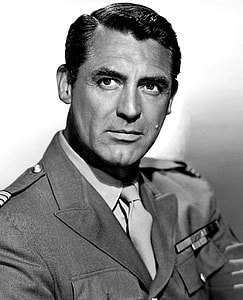 grayscale photograph of man in uniform