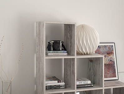 closeup photo of gray wooden cubby shelf