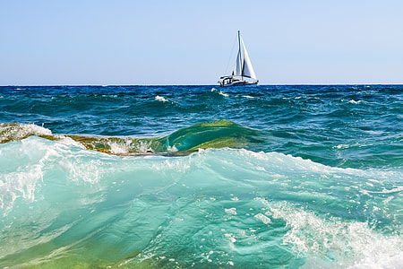 white sailboat on body of water at daytime