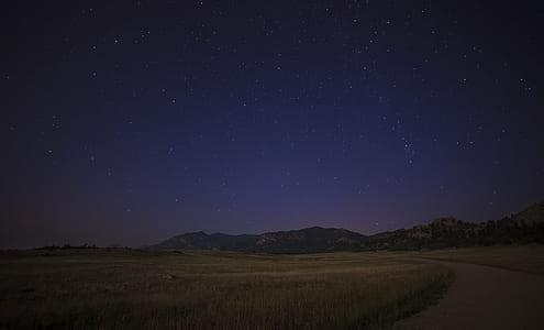 mountain under star sky
