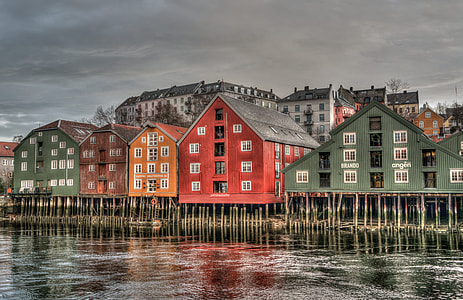 assorted-color wooden house shed on body of water