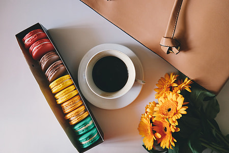 Overhead shot of coffee and macarons