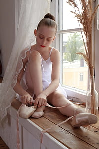 ballerina having shoes on window