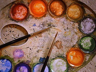 two paint brushes on paint bucket