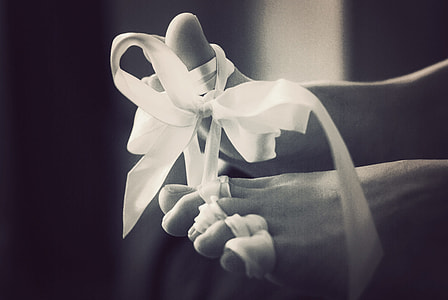 grayscale photo of ribbon tied toes